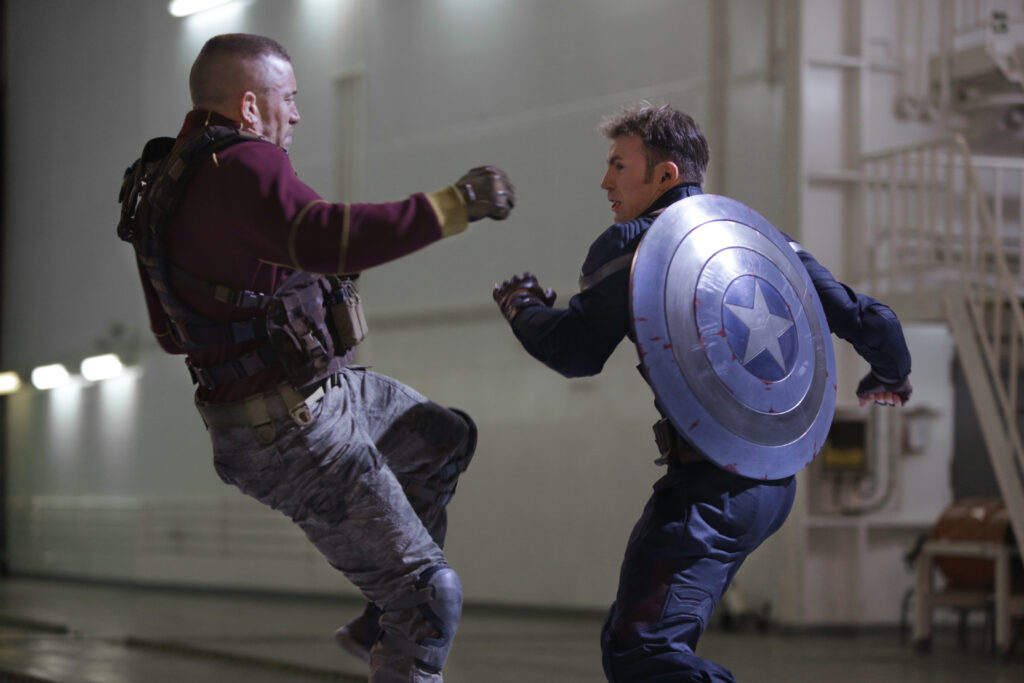 Marvel's Captain America: The Winter Soldier..L to R: Georges Batroc (George St-Pierre) & Captain America/Steve Rogers (Chris Evans)..Ph: Zade Rosenthal..? 2014 Marvel. All Rights Reserved.